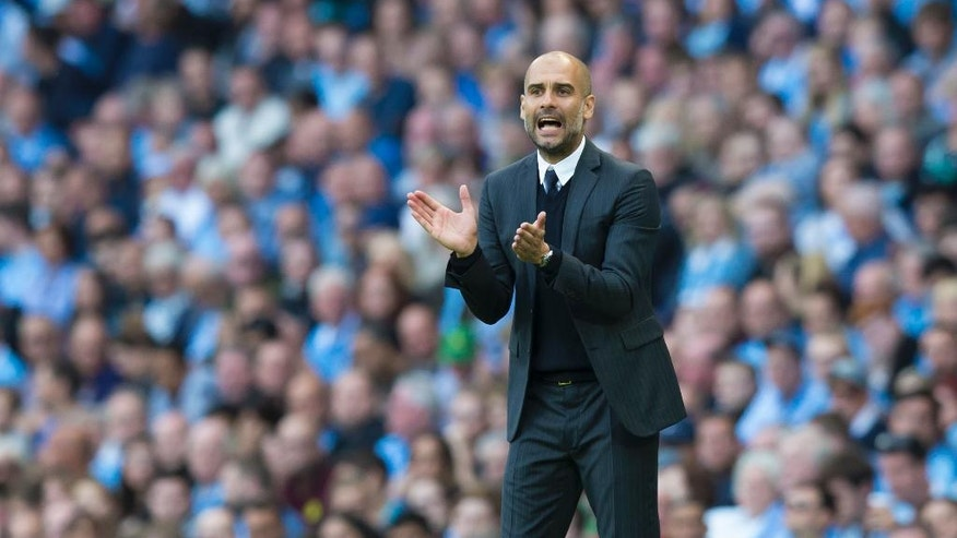 Manchester City's new manager Pep Guardiola applauds during the English Premier League soccer match between Manchester City and Sunderland at the Etihad Stadium in Manchester, England, Saturday Aug. 13, 2016. (AP Photo/Jon Super)