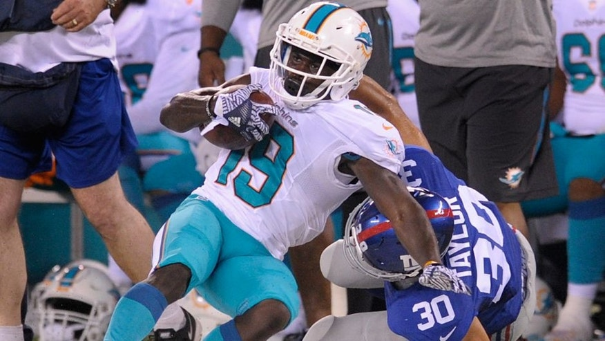 Miami Dolphins wide receiver Jakeem Grant (19) is tackled by New York Giants defensive back Cooper Taylor (30) during the third quarter of a preseason NFL football game, Friday, Aug. 12, 2016, in East Rutherford, N.J. (AP Photo/Bill Kostroun)