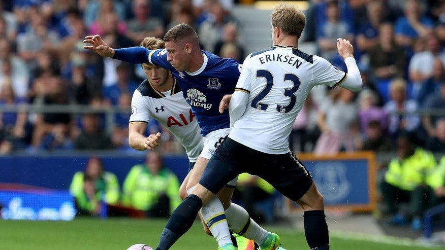 Tottenham Hotspur's Eric Dier, left, and Christian Eriksen, right, battle for the ball with Everton's Ross Barkley, centre, during their English Premier League soccer match at Goodison Park, Liverpool, England, Saturday, Aug. 13, 2016. (Peter Byrne/PA via AP)