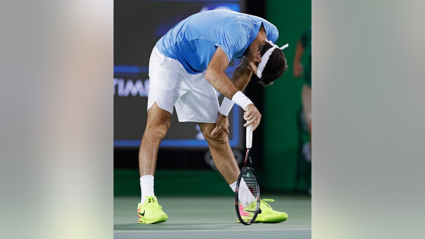 Juan Martin del Potro, of Argentina, beds over after losing a point to Andy Murray, of England, during their gold medal match at the 2016 Summer Olympics in Rio de Janeiro, Brazil, Sunday, Aug. 14, 2016. (AP Photo/Charles Krupa)