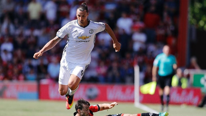 Manchester United's Zlatan Ibrahimovic, left, and Bournemouth's Harry Arter challenge for the ball during the English Premier League soccer match between Bournemouth and Manchester United at Vitality Stadium in Bournemouth, England, Sunday, Aug. 14, 2016. (AP Photo/Frank Augstein)