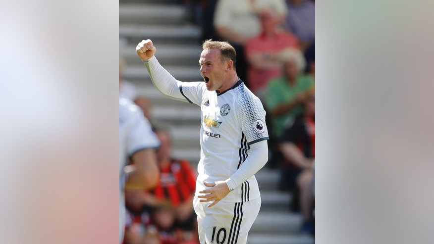 Manchester United's Wayne Rooney celebrates after scoring during the English Premier League soccer match between Bournemouth and Manchester United at Vitality Stadium in Bournemouth, England, Sunday, Aug. 14, 2016.(AP Photo/Frank Augstein)