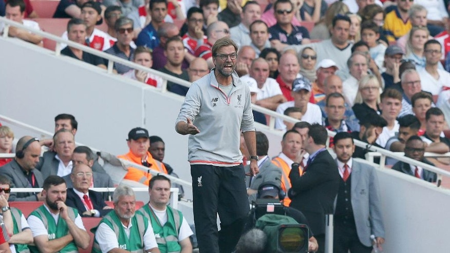 Liverpool's manager Jurgen Klopp shouts orders during the English Premier League soccer match between Arsenal and Liverpool at the Emirates Stadium in London, Sunday Aug. 14, 2016. (AP Photo/Tim Ireland)
