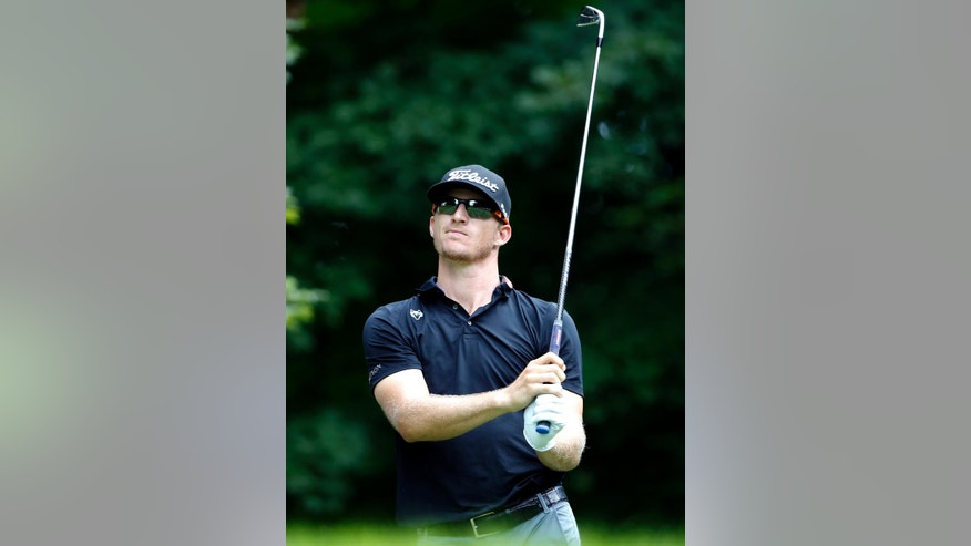 Morgan Hoffmann watches his tee shot on the sixth hole during the final round of the John Deere Classic golf tournament Sunday, Aug. 14, 2016, in Silvis, Ill. (AP Photo/Nam Y. Huh)