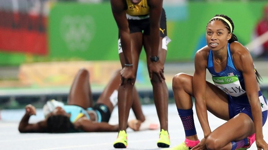 United States' Allyson Felix, right, looks at the scoreboard after the women's 400-meter final during the athletics competitions of the 2016 Summer Olympics at the Olympic stadium in Rio de Janeiro, Brazil, Monday, Aug. 15, 2016. (AP Photo/Lee Jin-man)