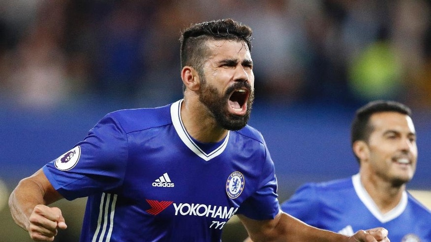 Chelsea's Diego Costa celebrates after scoring during the English Premier League soccer match between Chelsea and West Ham at Stamford Bridge stadium in London, Monday, Aug. 15, 2016.(AP Photo/Frank Augstein)