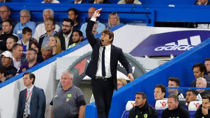 Chelsea's team manager Antonio Conte gestures during the English Premier League soccer match between Chelsea and West Ham at Stamford Bridge stadium in London, Monday, Aug. 15, 2016.(AP Photo/Frank Augstein)