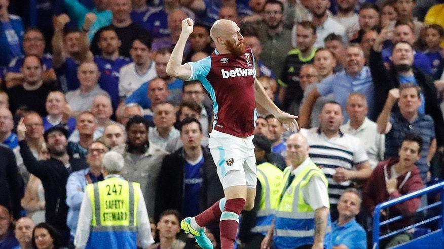 West Ham's James Collins, center celebrates after scoring during the English Premier League soccer match between Chelsea and West Ham at Stamford Bridge stadium in London, Monday, Aug. 15, 2016.(AP Photo/Frank Augstein)