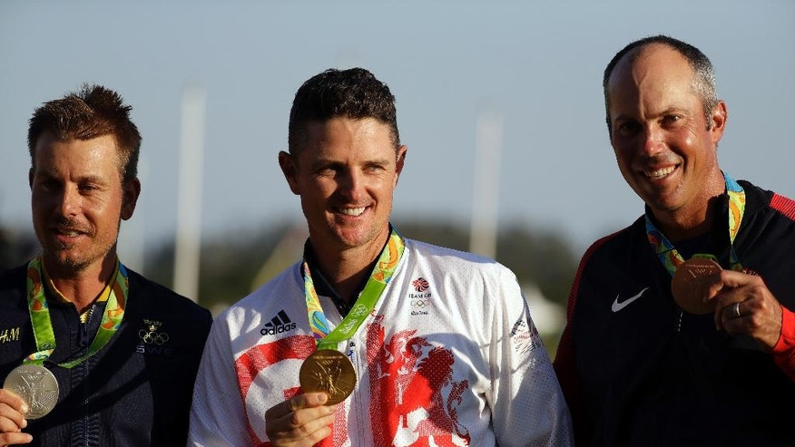 The medalists are seen from left to right, silver medalist Henrik Stenson of Sweden, gold medalist Justin Rose of Great Britain, and bronze medalist Matt Kuchar of the, United States, after the final round of the men's golf event at the 2016 Summer Olympics in Rio de Janeiro, Brazil, Sunday, Aug. 14, 2016. (AP Photo/Chris Carlson)