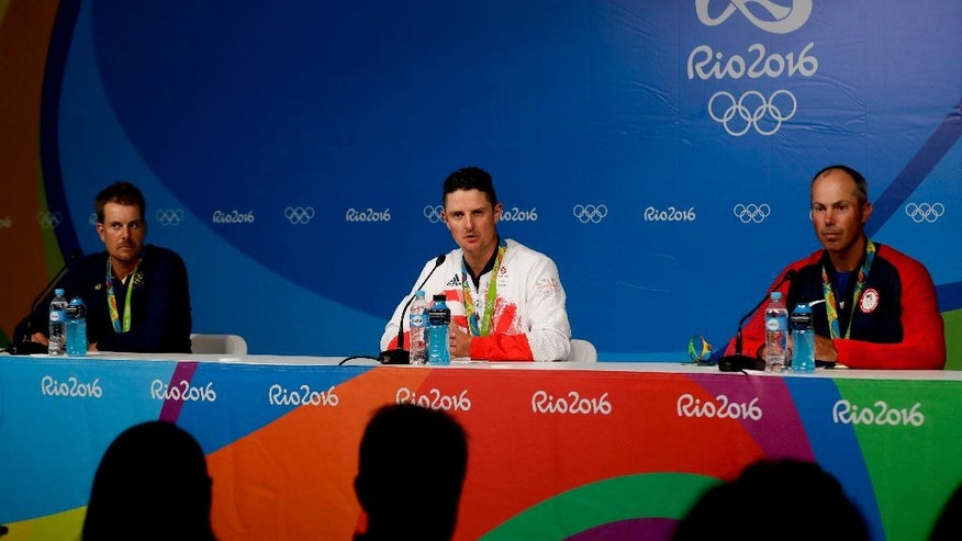 The medalists are seen from left to right, silver medalist Henrik Stenson of Sweden, gold medalist Justin Rose of Great Britain, and bronze medalist Matt Kuchar of the, United States, speak to the media during a news conference at the men's golf event at the 2016 Summer Olympics in Rio de Janeiro, Brazil, Sunday, Aug. 14, 2016. (AP Photo/Alastair Grant)