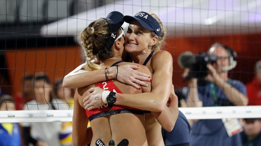 Kerri Walsh Jennings, right, and April Ross hug after beating Australia at the 2016 Summer Olympics.