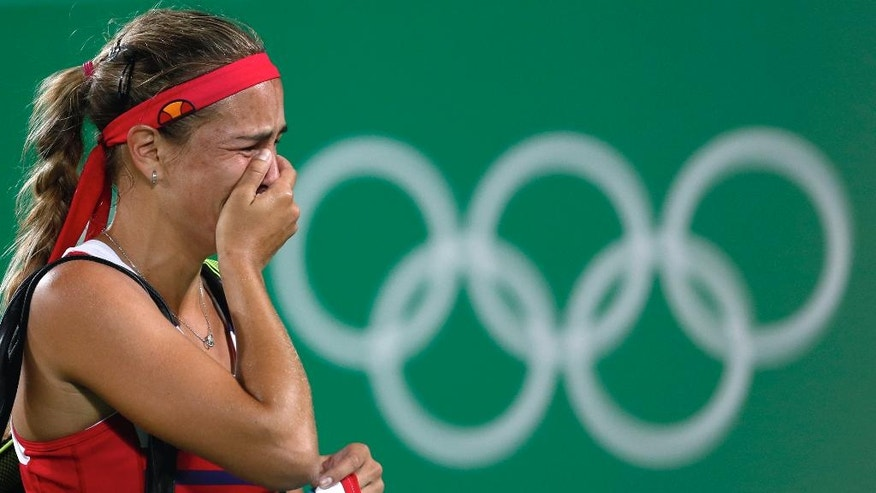 Monica Puig of Puerto Rico cries after winning the gold medal match in the women's tennis competition at the 2016 Summer Olympics in Rio de Janeiro, Brazil, Saturday, Aug. 13, 2016. (AP Photo/Vadim Ghirda)