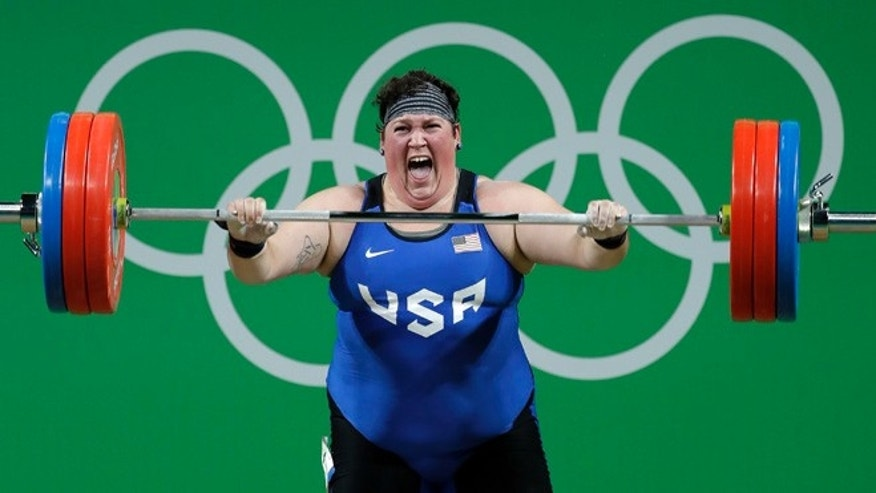 Sarah Elizabeth Robles, of the United States, yells after a successful lift in her final attempt in the clean and jerk portion of the women's 75kg weightlifting competition at the 2016 Summer Olympics in Rio de Janeiro, Brazil, Sunday, Aug. 14, 2016. (AP Photo/Mike Groll)