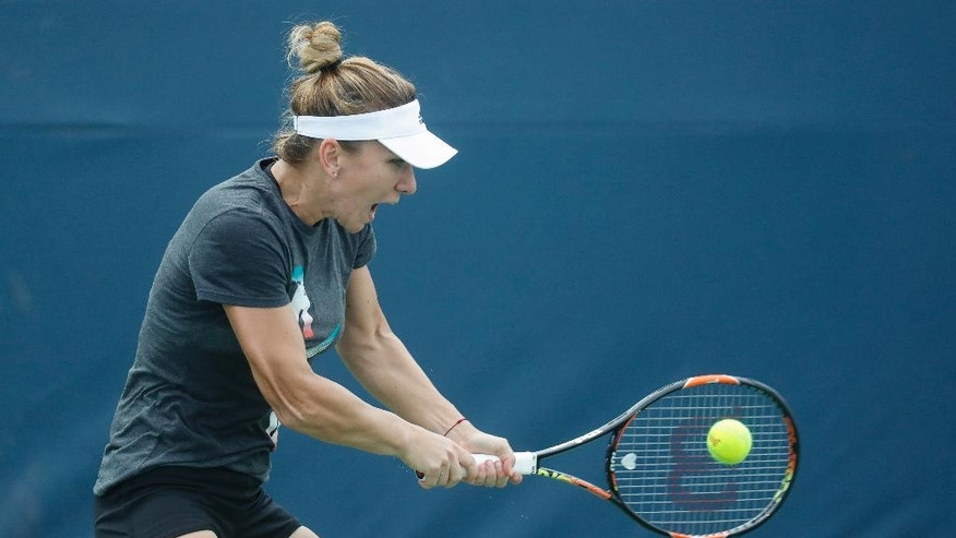 Simona Halep, of Romania, practices on the third day of the Western & Southern Open tennis tournament, Monday, Aug. 15, 2016, in Mason, Ohio. (AP Photo/John Minchillo)