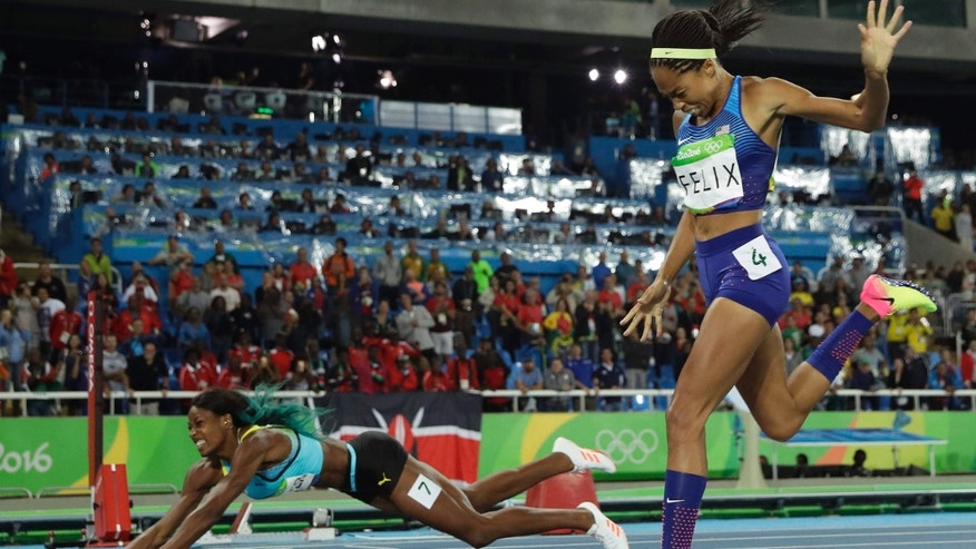 Aug.15, 2016: Bahamas' Shaunae Miller falls over the finish line to win gold ahead of United States' Allyson Felix, right, in the women's 400-meter final during the athletics competitions of the 2016 Summer Olympics at the Olympic stadium in Rio de Janeiro, Brazil.
