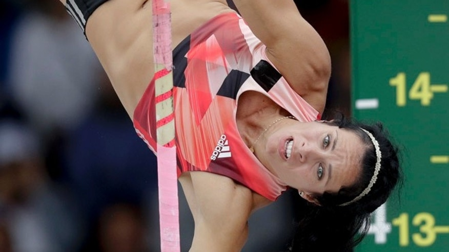 In this July 10, 2016 file photo, Jenn Suhr clears the bar during the women's pole vault final at the U.S. Olympic Track and Field Trials in Eugene Oregon.