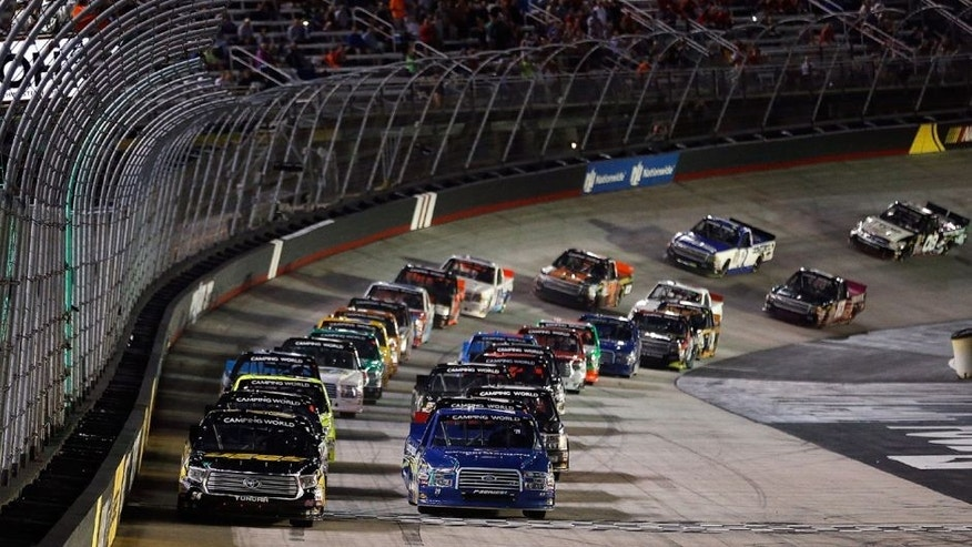 BRISTOL, TN - AUGUST 19: Kyle Busch, driver of the #54 JEGS Toyota, and Ryan Blaney, driver of the #29 Coopers Stard Ford, take the green flag during the NASCAR Camping World Truck Series UNOH 200 race, at Bristol Motor Speedway on August 19, 2015 in Bristol, Tennessee. (Photo by Brian Lawdermilk/NASCAR via Getty Images)