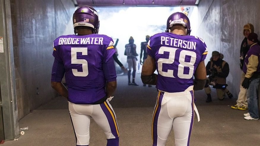 MINNEAPOLIS, MN - DECEMBER 27: Teddy Bridgewater #5 and Adrian Peterson #28 of the Minnesota Vikings prepare to go on field prior to an NFL game against the New York Giants at TCF Bank Stadium December 27, 2015 in Minneapolis, Minnesota. (Photo by Tom Dahlin/Getty Images)