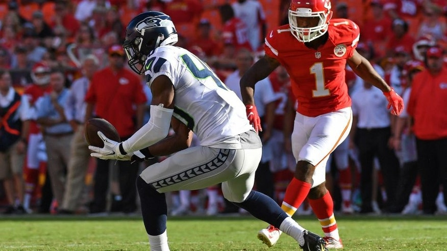 KANSAS CITY, MO - AUGUST 13: Safety Tyvis Powell of the Seattle Seahawks intercepts a pass against wide receiver Da'Ron Brown #1 of the Kansas City Chiefs during the second half on August 13, 2016 at Arrowhead Stadium in Kansas City, Missouri. (Photo by Peter Aiken/Getty Images)