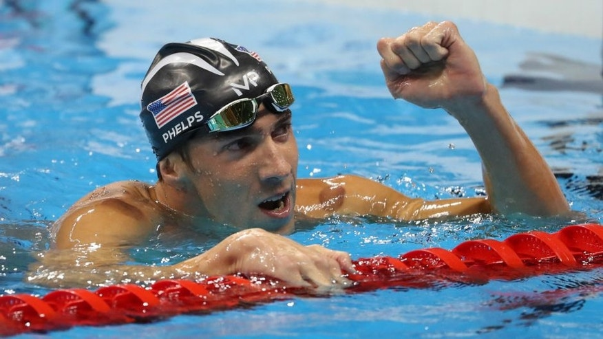 Aug 9, 2016; Rio de Janeiro, Brazil; Michael Phelps (USA) reacts after winning the men's 200m butterfly final in the Rio 2016 Summer Olympic Games at Olympic Aquatics Stadium. Mandatory Credit: Jason Getz-USA TODAY Sports