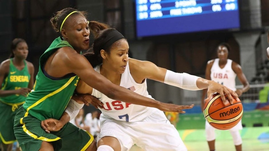 Sunday, Aug. 7, 2016: United States forward Maya Moore (right), of the Minnesota Lynx, is pressured by Senegal power forward Astou Traore during the Rio 2016 Summer Olympic Games at Youth Arena. Team USA set three Olympic records in a 121-56 win: Points scored in a game, margin of victory and assists.