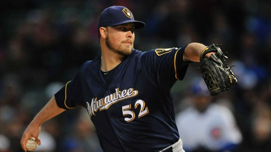 Milwaukee Brewers starter Jimmy Nelson delivers a pitch during the first inning of a baseball game against the Chicago Cubs Tuesday, April 26, 2016, in Chicago. (AP Photo/Paul Beaty)