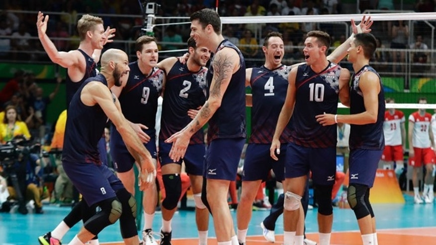 The United States volleyball team celebrates a victory over Poland in a men's quarterfinal volleyball match at the 2016 Summer Olympics in Rio de Janeiro, Brazil, Wednesday, Aug. 17, 2016.