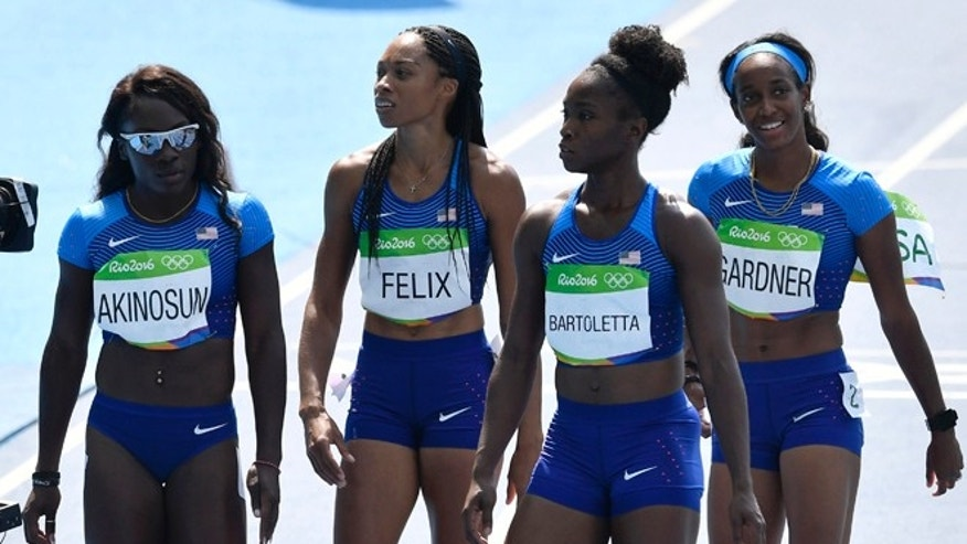 From left, the United States 4x100-meter relay team Morolake Akinosun, Allyson Felix, Tianna Bartoletta and English Gardner after a women's 4x100-meter relay heat during the athletics competitions of the 2016 Summer Olympics at the Olympic stadium in Rio de Janeiro, Brazil, Thursday, Aug. 18, 2016.