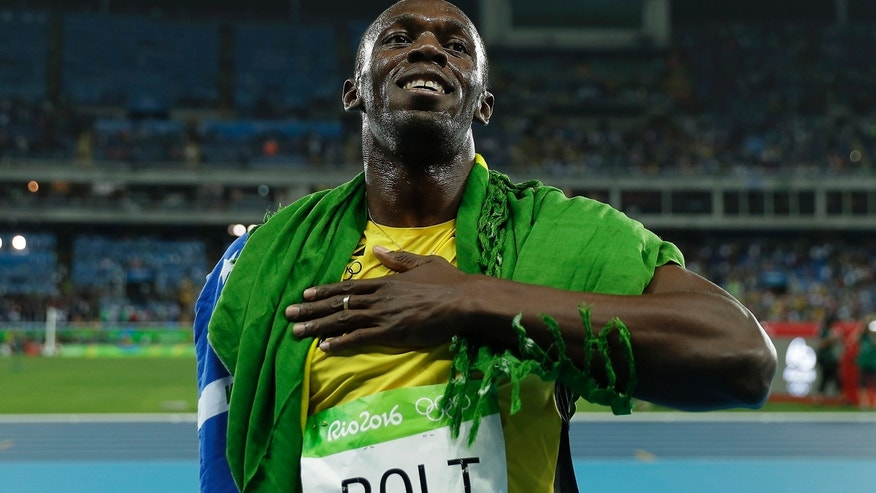 Aug. 18, 2016: Usain Bolt from Jamaica celebrates after winning the gold medal in the men's 200-meter final, during the athletics competitions of the 2016 Summer Olympics at the Olympic stadium in Rio de Janeiro, Brazil.