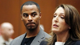 FILE - In this Feb. 20, 2014, file photo, Darren Sharper looks toward his attorney, Blair Berk, during an appearance in Los Angeles Superior Court in Los Angeles. Former NFL star Darren Sharper has been sentenced to 18 years in prison in a case where he was accused of drugging and raping as many as 16 women in four states. Judge Jane Triche Milazzo sentenced Sharper on Thursday, Aug. 18, 2016, in New Orleans. (AP Photo/Mario Anzuoni, Pool, File)