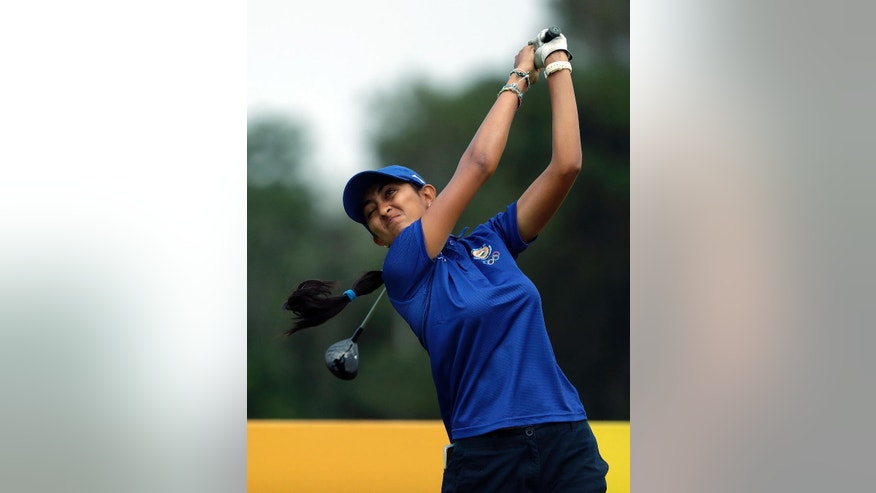 Aditi Ashok of India, hits her tee shot on the 3rd hole during the second round of the women's golf event at the 2016 Summer Olympics in Rio de Janeiro, Brazil, Thursday, Aug. 18, 2016. (AP Photo/Alastair Grant)