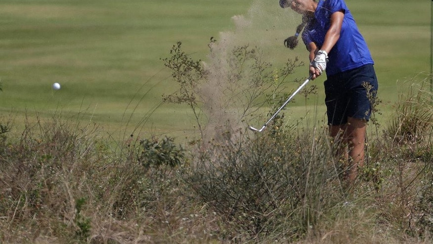 Aditi Ashok of India, hits from the waste area on the 18th hole during the second round of the women's golf event at the 2016 Summer Olympics in Rio de Janeiro, Brazil, Thursday, Aug. 18, 2016. (AP Photo/Chris Carlson)