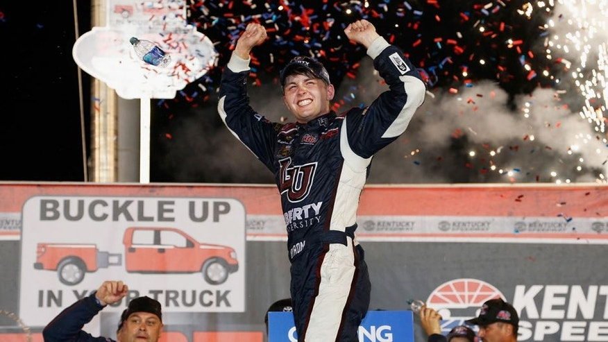 SPARTA, KY - JULY 07: William Byron, driver of the #9 Liberty University Toyota, celebrates in Victory Lane after winning the NASCAR Camping World Truck Series Buckle Up In Your Truck 225 at Kentucky Speedway on July 7, 2016 in Sparta, Kentucky. (Photo by Brian Lawdermilk/NASCAR via Getty Images)