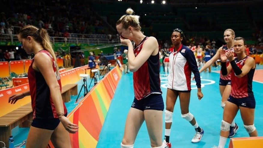 Members of the United States team walk off the court after losing a women's semifinal volleyball match against Serbia at the 2016 Summer Olympics in Rio de Janeiro, Brazil, Thursday, Aug. 18, 2016. (AP Photo/Matt Rourke)