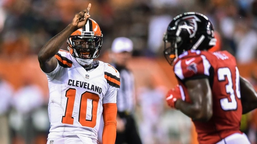 Cleveland Browns quarterback Robert Griffin III (10) reacts after tight end Gary Barnidge scored a touchdown during the first half of an NFL preseason football game against the Atlanta Falcons, Thursday, Aug. 18, 2016, in Cleveland. (AP Photo/David Richard)