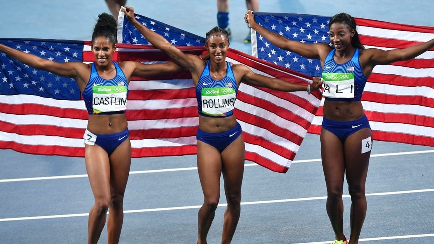Aug. 17, 2016: Gold medal winner United States' Brianna Rollins, center, silver medal winner United States' Nia Ali, right, and bronze medal winner United States' Kristi Castlin celebrate after the women's 100-meter hurdles final during the athletics competitions of the 2016 Summer Olympics at the Olympic stadium in Rio de Janeiro, Brazil.