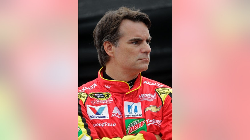 Jeff Gordon watches cars go past during practice for a NASCAR Sprint Cup Series auto race, Friday, Aug. 19, 2016 in Bristol, Tenn. (AP Photo/Wade Payne)