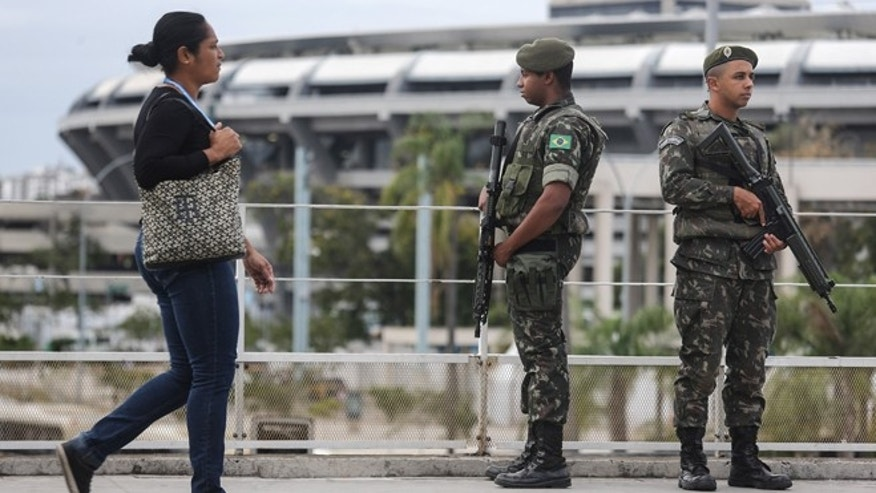 RIO DE JANEIRO, BRAZIL - JULY 17:  Brazilian soldiers stand on patrol during a security rehearsal of the Rio 2016 Olympic Games opening ceremony outside Maracana stadium on July 17, 2016 in Rio de Janeiro, Brazil. Brazil announced July 15 it was bolstering security for the Olympics following the truck attack in Nice, France, which killed at least 84 people. The Olympics opening ceremony is August 5 at Maracana stadium.  (Photo by Mario Tama/Getty Images)