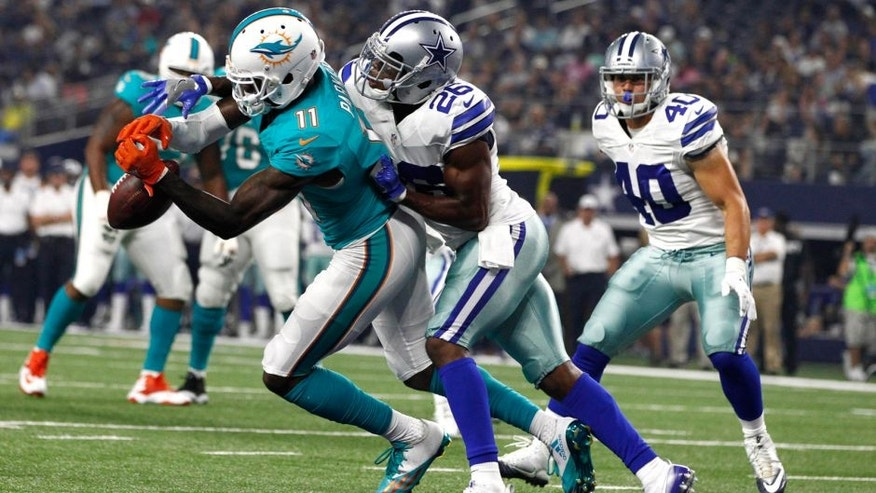 Aug 19, 2016; Arlington, TX, USA; Dallas Cowboys defensive back Josh Thomas (26) defends a pass against Miami Dolphins wide receiver DeVante Parker (11) in the second quarter at AT&T Stadium. Mandatory Credit: Tim Heitman-USA TODAY Sports