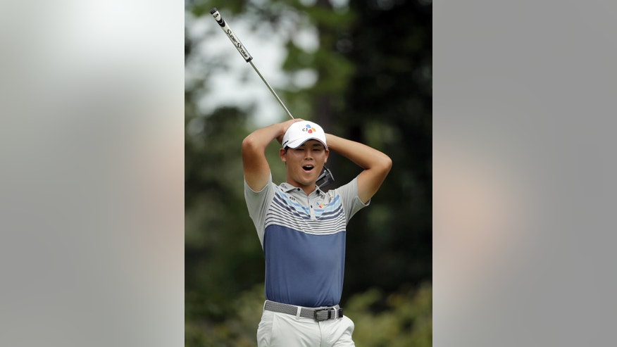 Si Woo Kim reacts to missing a birdie putt on the ninth hole during the second round of the Wyndham Championship golf tournament in Greensboro, N.C., Friday, Aug. 19, 2016. (AP Photo/Chuck Burton)