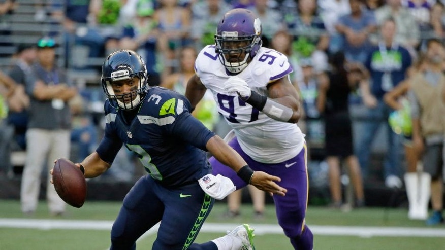 Minnesota Vikings defensive end Everson Griffen prepares to sack Seattle Seahawks quarterback Russell Wilson during the first half of a preseason NFL football game, Thursday, Aug. 18, 2016, in Seattle.