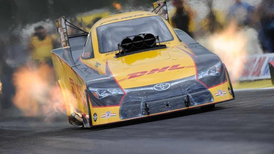 In this photo provided by the NHRA, Del Worsham drives in Funny Car qualifying Friday, Aug. 19, 2016, at the Lucas Oil NHRA Nationals drage races in Brainerd, Minn. Worsham took the provisional qualifying lead with a 3.856-second pass at 326.71 mph. (Marc Gewertz/NHRA via AP)