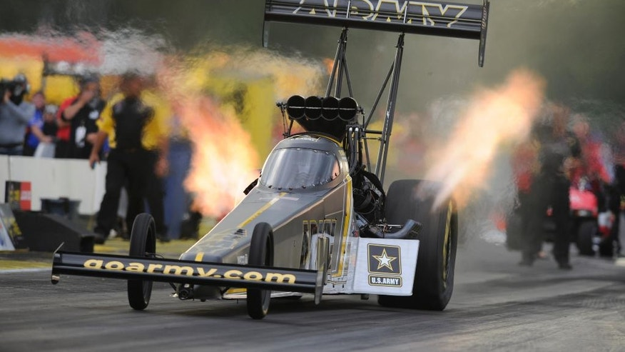 In this photo provided by NHRA, Tony Schumacher drives during Top Fuel qualifying Friday, Aug. 19, 2016, at the Lucas Oil NHRA Nationals drag races in Brainerd, Minn. Schumacher led the first day of qualifying with a run of 3.712 seconds at 323.50 mph. (Jerry Foss/NHRA via AP)