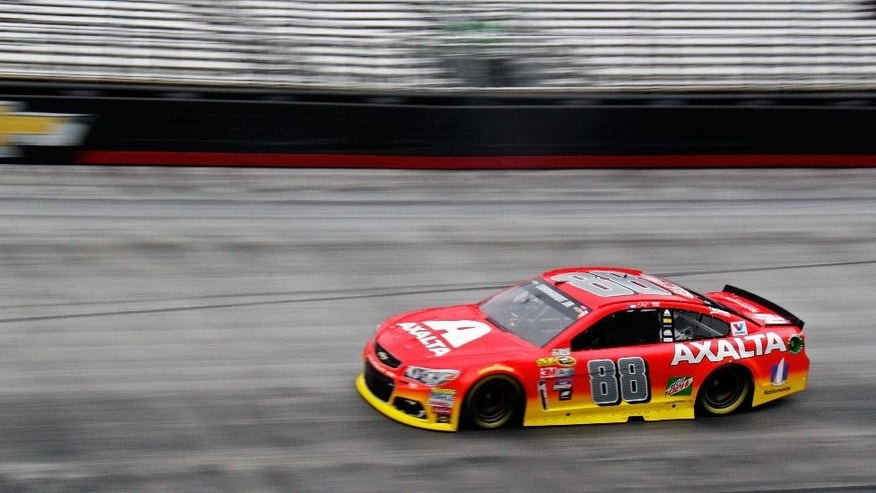 Jeff Gordon, driving for injured Dale Earnhardt Jr., makes his way around Bristol Motor Speedway during practice for a NASCAR Sprint Cup Series auto race, Friday, Aug. 19, 2016 in Bristol, Tenn. (AP Photo/Wade Payne)