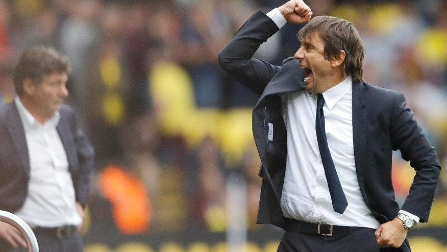 Chelsea's team manager Antonio Conte celebrates after his team won the English Premier League soccer match between Watford and Chelsea at Vicarage Road stadium in London, Saturday, Aug. 20, 2016. (AP Photo/Frank Augstein)