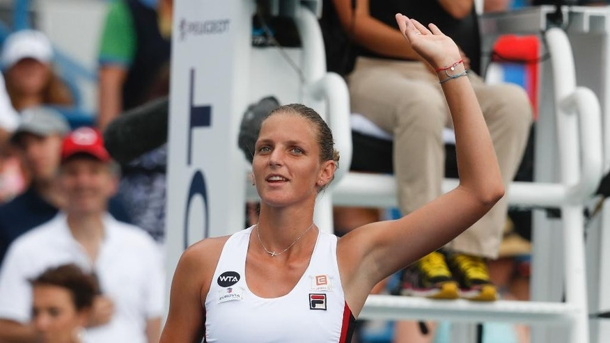 Karolina Pliskova, of the Czech Republic, waves to the crowd after winning he match against Garbine Muguruza, of Spain, during the semifinals of the Western & Southern Open tennis tournament, Saturday, Aug. 20, 2016, in Mason, Ohio. Pliskova won 6-1, 6-3. (AP Photo/John Minchillo)