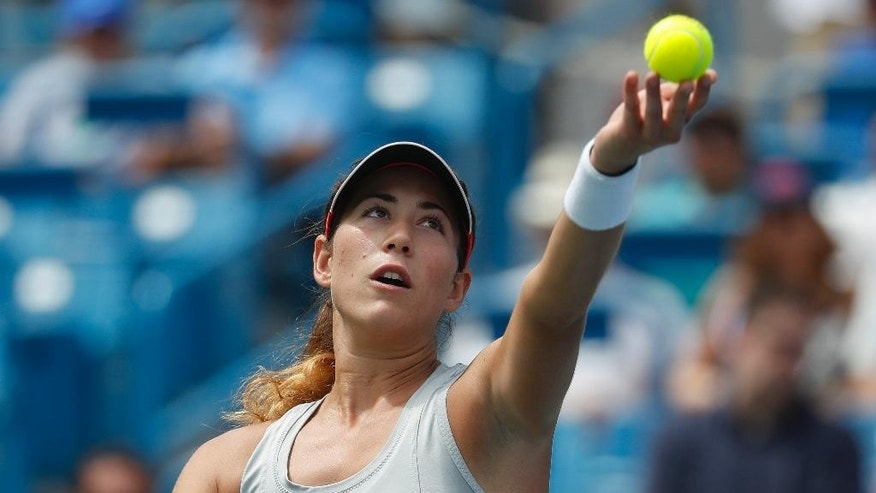 Garbine Muguruza, of Spain, serves to Karolina Pliskova, of the Czech Republic, during the semifinals of the Western & Southern Open tennis tournament, Saturday, Aug. 20, 2016, in Mason, Ohio. (AP Photo/John Minchillo)