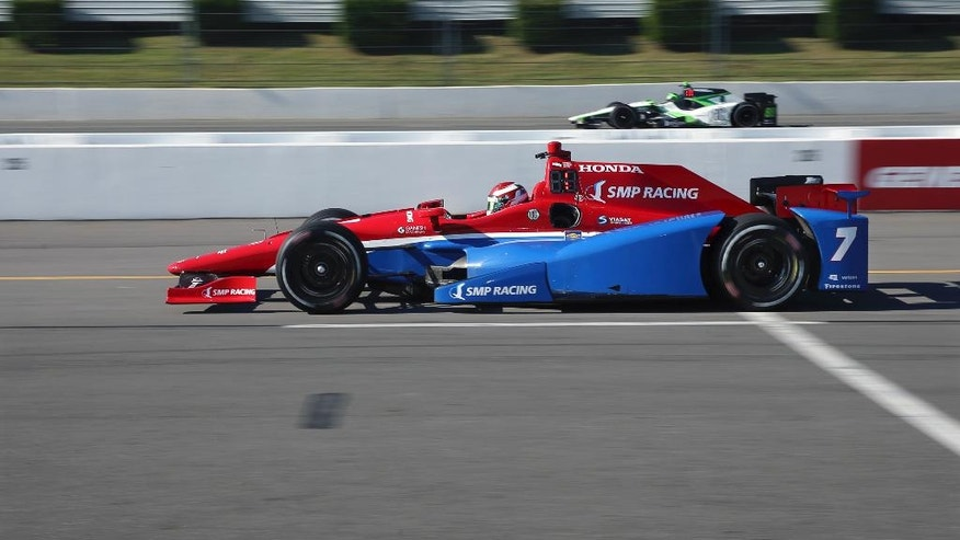 Mikhall Aleshin, of Russia, (7) drives from a pit stop during practice for Sunday's Pocono IndyCar 500 auto race Saturday, Aug. 20, 2016 in Long Pond, Pa. (AP Photo/Mel Evans)