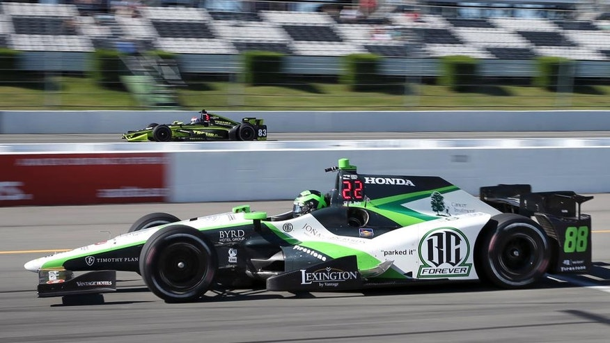 Conor Daly (88) drives his BC Forever car, during practice for Sunday's Pocono IndyCar 500 auto race Saturday, Aug. 20, 2016 in Long Pond, Pa., during  a tribute to teammate Bryan Clauson, who died Aug. 7, 2016, following an accident in a midget race auto race.  (AP Photo/Mel Evans)