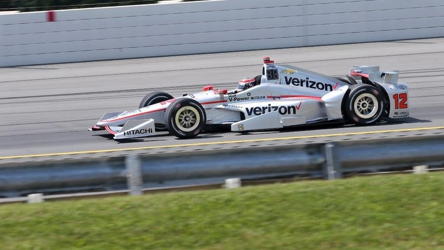 Will Power, of Australia, (12) drives during qualifying for Sunday's Pocono IndyCar 500 auto race Saturday, Aug. 20, 2016, in Long Pond, Pa. (AP Photo/Mel Evans)